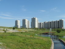 Park and residential buildings Royalty Free Stock Photos