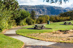 Park rest area. Rest area with picnic tables and a river view Stock Photography