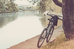 Park with river and bicycle track/bicycle track in park near the river stock photography