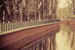 Park with river and embankment covered with snow Royalty Free Stock Photography