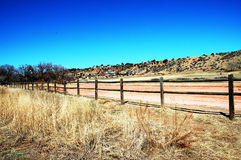 Park road with fence Stock Photography