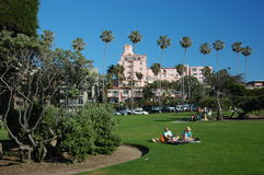 Park in San Diego. People out enjoying the sun and clear weather and blue sky of southern California at a beautiful park in downtown San Diego Royalty Free Stock Image