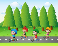 Park scene with kids riding bike Stock Images