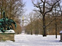 Park, sculpture, bare trees, snow, winter and sky. White park in Germany, nature, bare trees, snow, winter, sky, art, sculptures, statues, long path and walking stock photo