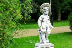 Park sculpture at the Sanatorium «Marble Palace». A boy with a Royalty Free Stock Photo