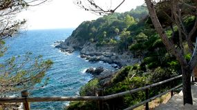 Park by the sea. View of the water and walking paths in the Park, near the monument to Donna Mariner. Lloret de Mar royalty free stock photos
