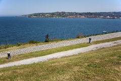 Park and sea. Photo of a landscape with sea, green grass and sunlight Stock Photos