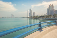 Park on the seafront against the backdrop of Abu Dhabi buildings Royalty Free Stock Photography