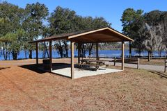 Park shelter in public park. This park is then Hanahan South Carolina. The reservoir in the background is full of gators Royalty Free Stock Photos