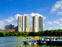 Park sightseeing boats dock in Shanghai. Park sightseeing boats dock with modern apartments buildings background in Shanghai China Royalty Free Stock Image