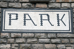 Park Sign. An old brick wall with a park sign set in the wall Stock Photos
