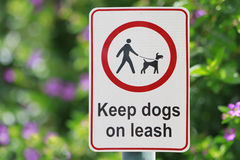Park Sign 2. Keep dogs on leash sign at a park Royalty Free Stock Images