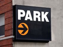 Park Sign arrow direction. On brick wall Royalty Free Stock Photo