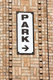 Park sign on brick wall Royalty Free Stock Photography