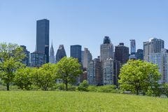 Park and skyline of Midtown Manhattan in New York City royalty free stock image
