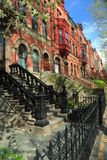 Park Slope Stoop. Brick and brownstone apartment buildings in Spring in Park Slope, Brooklyn, New York royalty free stock image