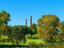 Park and smokestacks Royalty Free Stock Images