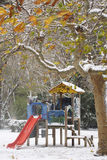 Park in the snow. Slide and Wooden house. Royalty Free Stock Photos