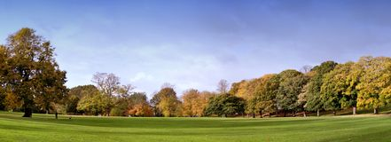 Park in Spring. Panoramic picture of a park in Autumn Stock Photo