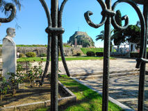 A park a statue and the old fortress in the background. In Corfu island Greece Stock Photography