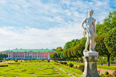 Park with statues and Palace of Kuskovo Stock Image