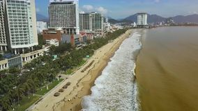 Park Strip between Beach and Hotels on Sea Coast Aerial View. Aerial view long green park strip between Yellow sea beach and high hotels after powerful typhoon stock footage