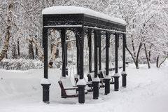 Park swing during snowstorm at winter in Moscow, Russia. Scenic view of a snowy city street. Moscow snowfall background royalty free stock photo