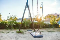 Park with swings on the seafront of Malvarosa. Valencia, Spain royalty free stock photos