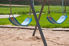 Park Swings sitting idle Stock Image