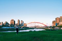 Park of Taipei. Walking in park of Taipei by the river and see the bridge at the middle Stock Photo