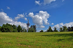Park, trees and cloudy blue sky. Sunny summer day in park Stock Images