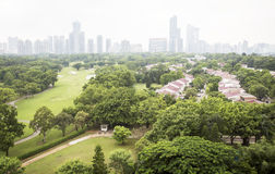 Park, trees and modern bussiness buildings in Beijing, China Royalty Free Stock Image