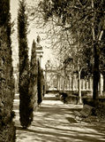 Park with trees and sculptures in sepia tone Stock Photo