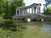 Park in Tsarskoye selo, Russia. Building in park (bridge with colonade) in park of king's palace in Tsarskoye selo (King's village), surroundings of St Royalty Free Stock Images