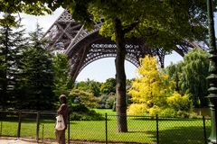 The park under the Eiffel Tower during summer stock photography