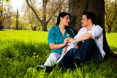 Park vacations. Outdoor couple sitting on tree after riding tour Stock Images