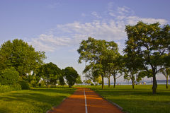 Park view. A view of a park under clear blue sky and green trees Royalty Free Stock Images