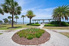 A park with a view of the Matanzas River and the Bridge of Lions in Historic St. Augustine, Florida USA. This is a view of a park along the Matanzas River with a Stock Photos