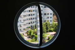 Park, visible from round window Royalty Free Stock Photo