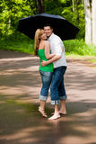 Park walk couple umbrella Royalty Free Stock Photo