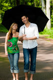 Park walk couple umbrella Stock Photo