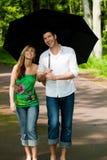Park Walk Couple Umbrella Stock Photo