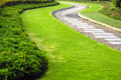 Park Walkway. Winding walkway surrounded by well-manicured garden Stock Image