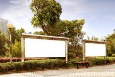 Park white billboard. Blank billboard in the public park stock photos