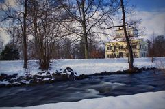 Park in winter. Winter park at sunset with historic building. Captured by a longer exposure Stock Photo