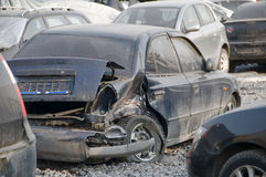 Park wrecked cars. A view of demolished cars in a junkyard Stock Images