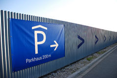 Park your car here. Sign leading to a parking garage in Munich, Germany Stock Images