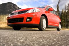 Parked. Red family car,shot taken from ground level royalty free stock photos