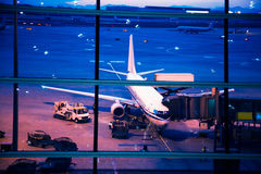 Parked aircraft on beijing airport through the gate window Royalty Free Stock Photos