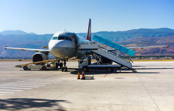 Parked aircraft on lijiang airport Royalty Free Stock Photography